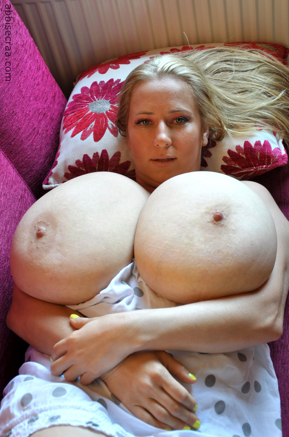 Big tits laying down nude