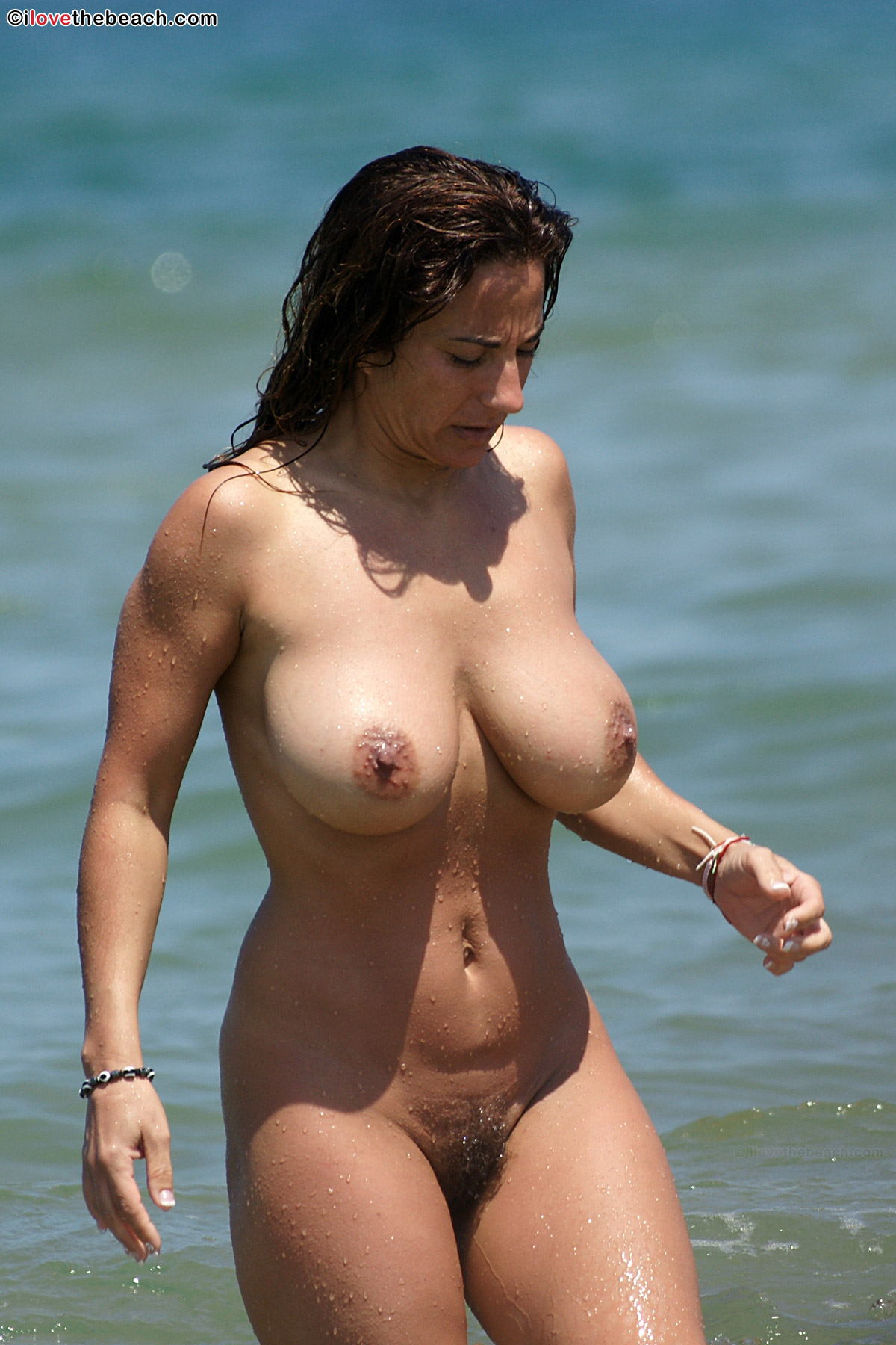Squeezing busty nude babes on beach — 1