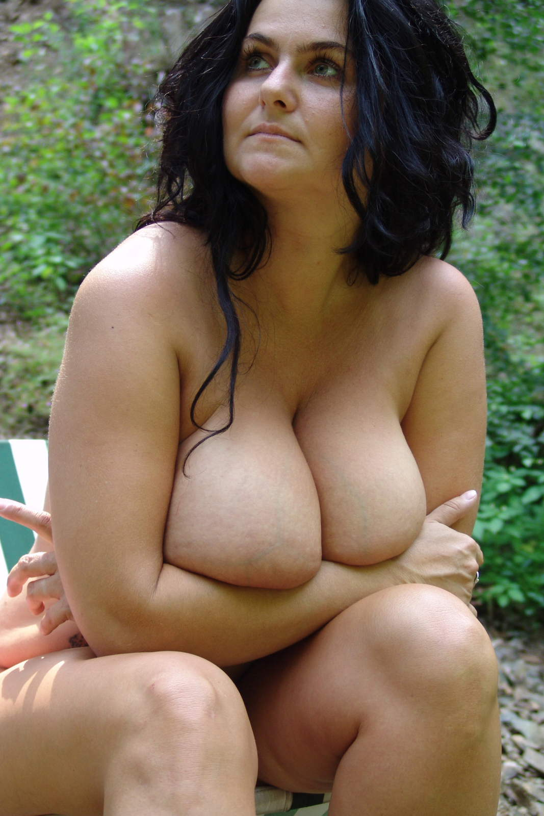 Milf busty reny shows her gigantic boobs at the camera 6