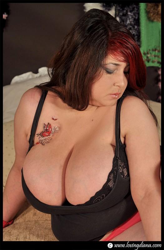 image Huge boobs webcam model fingering herself