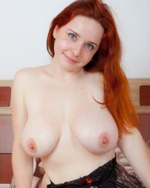 nude posing Busty redhead