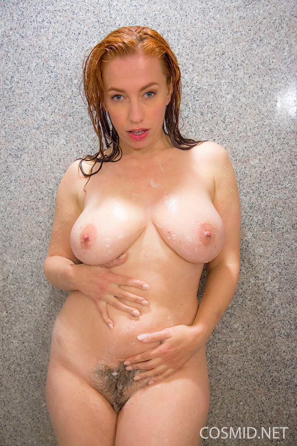 Busty redhead shows us her big naturals and hairy pussy 9