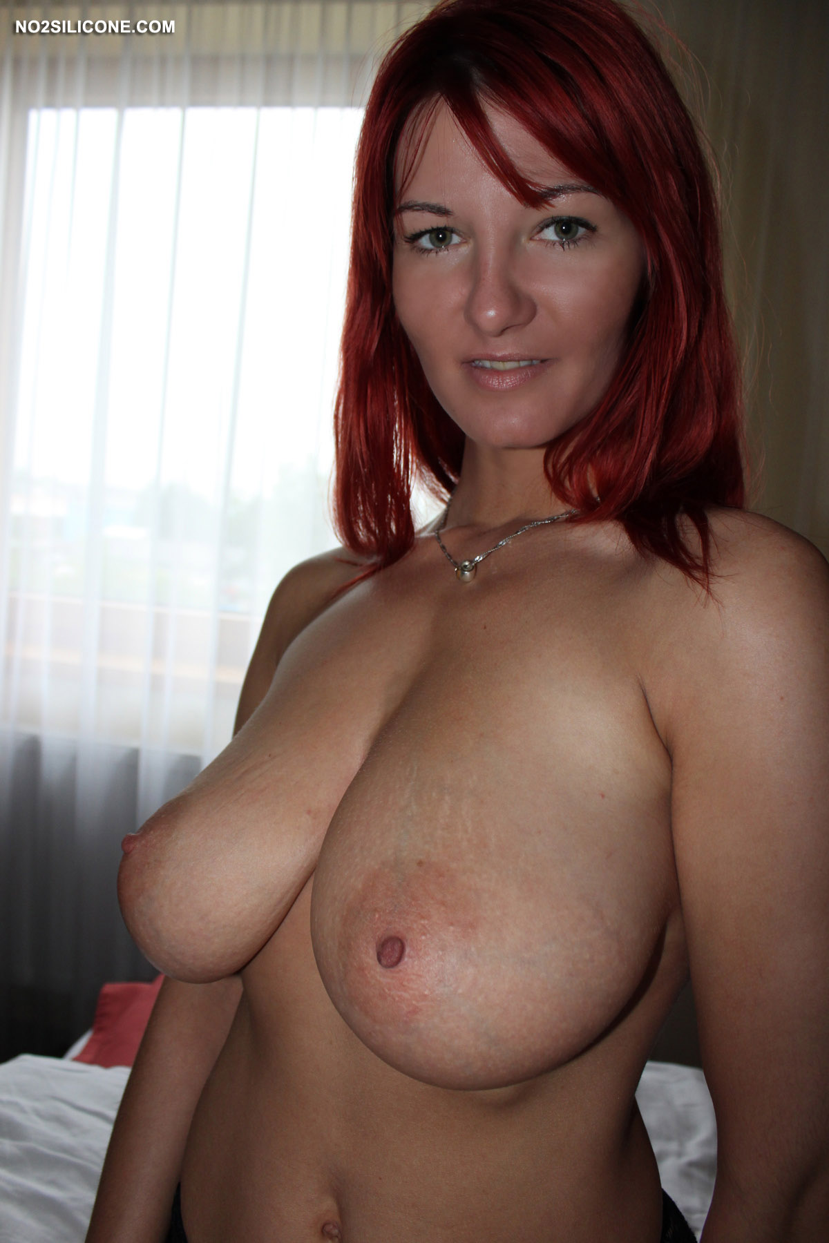 Bubbly redhead shows her body in detail