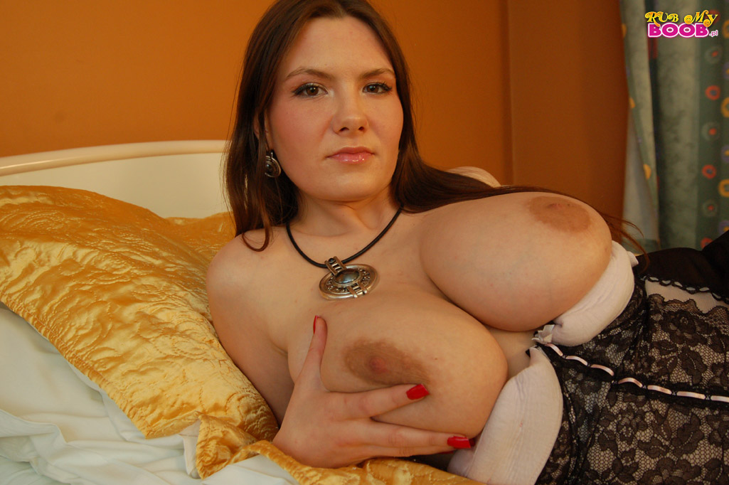 Polish centerfold ewa sonnet rubs her huge boobs